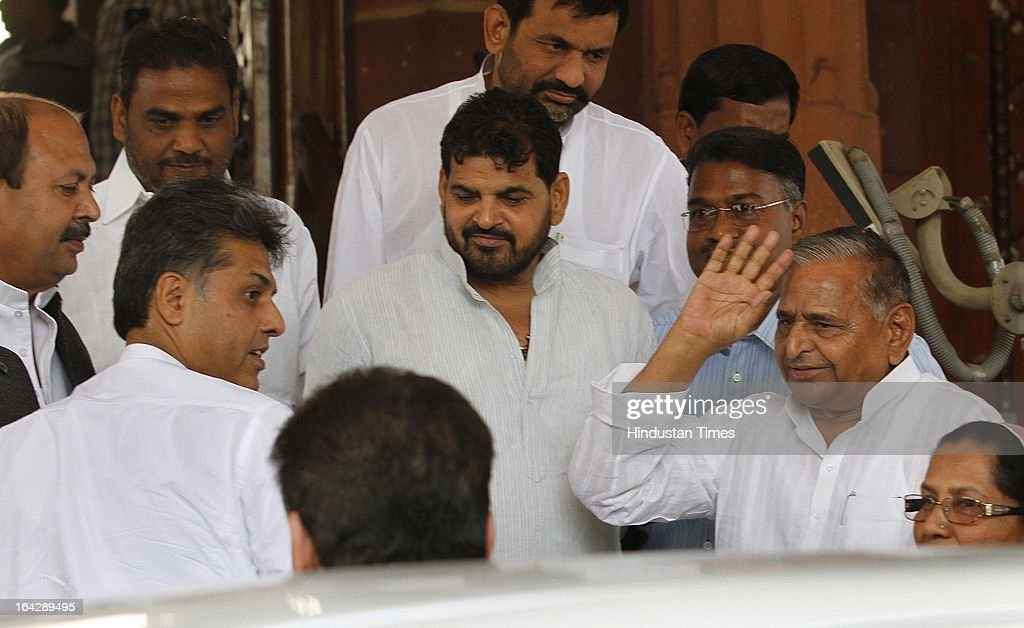Samajwadi Party Leader Mulayam Singh with Manish Tewari Union Minister for Information and Broadcasting ( left ) at Parliament house for ongoing Budget Session on March 22, 2013 in New Delhi, India. The Lok Sabha failed to transact any business for the third consecutive day as proceedings remained paralysed over the Sri Lankan Tamils issue.