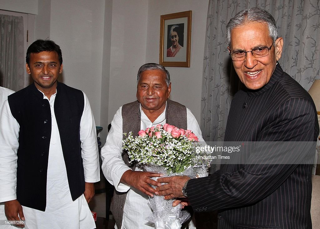 Samajwadi Party leader <a gi-track='captionPersonalityLinkClicked' href=/galleries/search?phrase=Mulayam+Singh+Yadav&family=editorial&specificpeople=689640 ng-click='$event.stopPropagation()'>Mulayam Singh Yadav</a> (C) and his son Akhilesh Yadav (L) meet with Governor of Uttar Pradesh Banwari Lal Joshi at the governor's house to stake a claim of forming a government on March 7, 2012 in Lucknow, India. Samajwadi Party secured a clear majority by winning 224 assembly seats out 403.