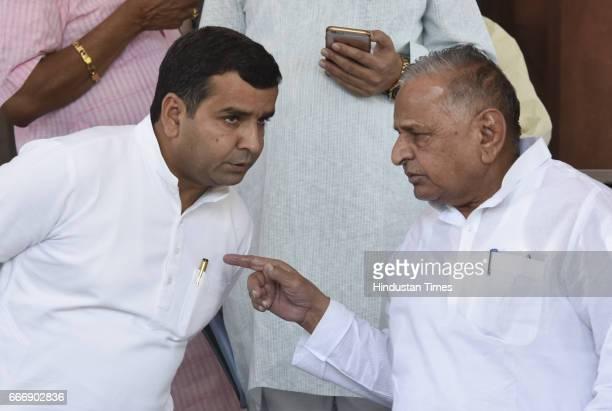 Samajwadi Party leader Mulayam Singh Yadav and Mahendra Yadav at Parliament during the second leg of Budget Session on April 10 2017 in New Delhi...