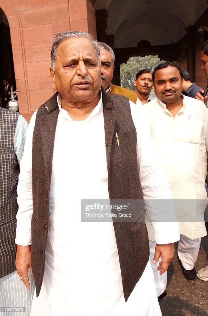 Samajwadi Party leader Mulayam Singh Yadav walks out after attending the Winter Session in New Delhi on November 11 2010