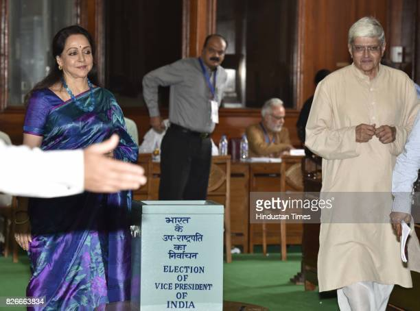 VicePresidential candidate Gopal Krishna Gandhi looks on while BJP leader Hema Malini casts her vote for Vice Presidential Election at Parliament...