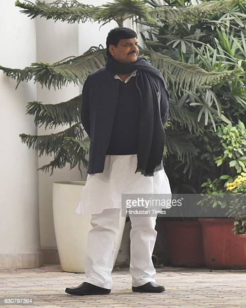 Samajwadi Party leader Shivpal Yadav at Mulayam Singh Yadav's residence before leaving to meet Election Commission to stake claim to the 'cycle'...