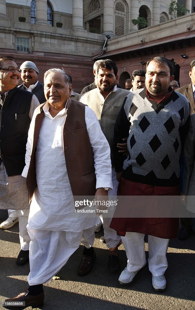 Samajwadi Party president Mulayam Singh Yadav with MP, Yashvir Singh (R), who snatched the copy of SC/ST Quota Bill from Narayanasamy in Lok Sabha at Parliament House on December 19, 2012 in New Delhi, India.