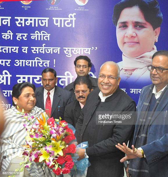 Samajwadi Party senior leader Ambika Chaudhary joins BSP in the presence of party Supremo Mayawati at the party office on January 21 2016 in Lucknow...