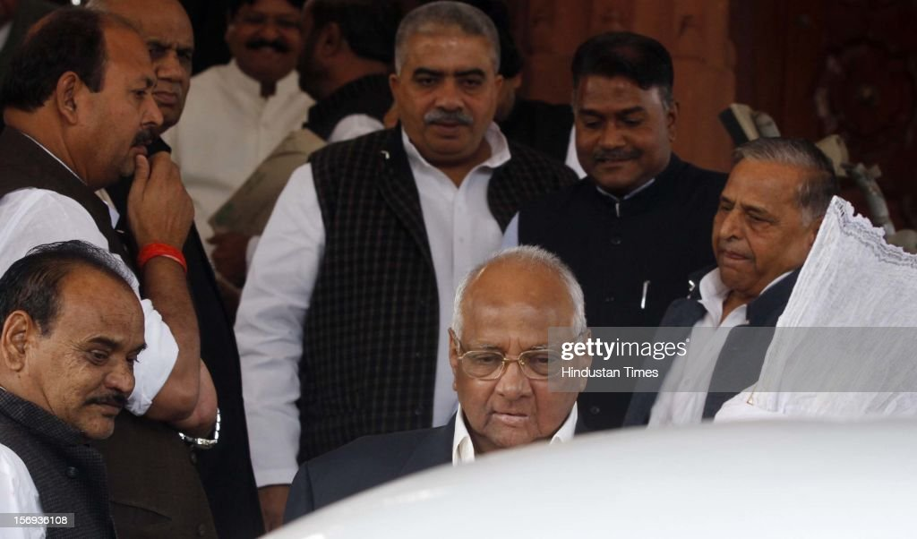 Samajwadi Party supremo Mulayam Singh Yadav(Right) and NCP Chief Sharad Pawar(centre) with others at Parliament House during the winter session, on November 23, 2012 in New Delhi, India.