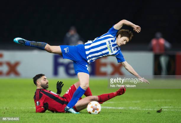 Saman Ghoddos of Ostersunds FK and Genki Haraguchi of Herta Berlin SC competes for the ball during the UEFA Europa League group J match between...