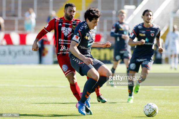 Saman Ghoddos of Ostersunds FK and Marko Biskupovic of Kalmar FF in action during the Allsvenskan match between Ostersunds FK and Kalmar FF at...