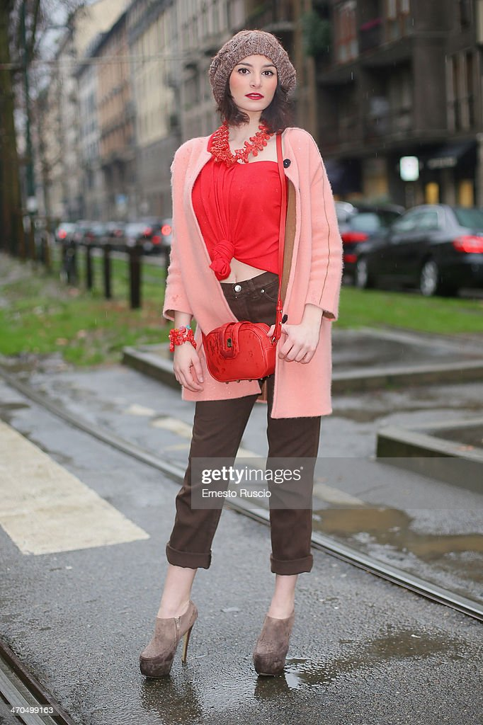 Samanta wears Valentino trousers and Front Row coat on day 1 of Milan Fashion Week Womenswear Autumn/Winter 2014 on February 19, 2014 in Milan, Italy.