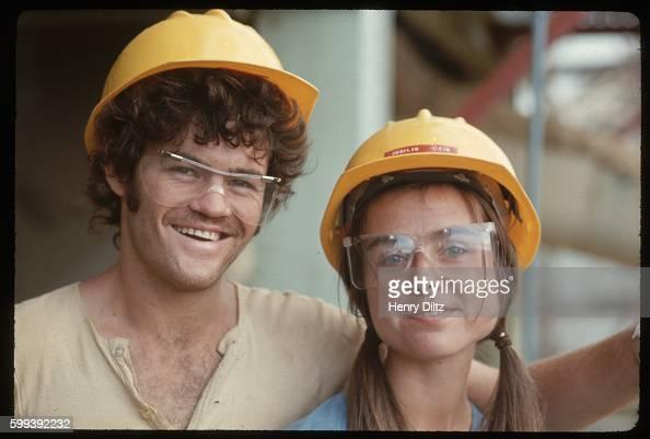 Samantha and Micky Dolenz wear hard hats while touring a sugar cane refinery in Kohala Hawaii