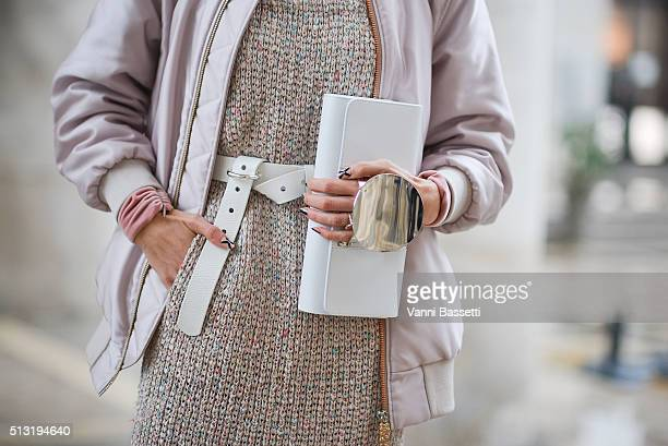 Samantha Angelo poses wearing an Acne Studios bomber jacket and belt A Moi jumper and Perrin bag before the Anrealage show at the Palais de Tokyo...