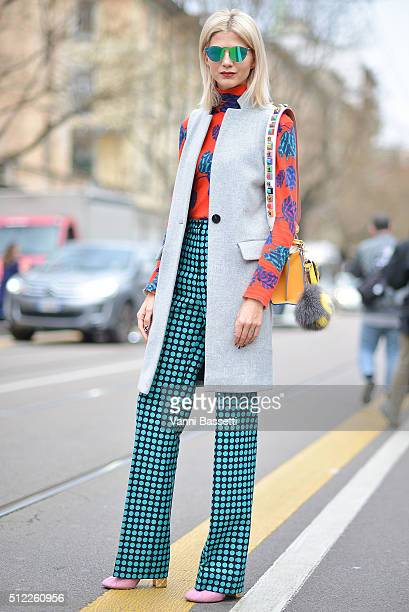 Samantha Angelo poses wearing Marc Jacob top Bottega Veneta pants Chanel shoes and Fendi bag before the Fendi show during the Milan Fashion Week...
