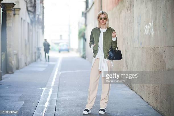 Samantha Angelo poses wearing Topshop bomber jacket Chloe pants and Prada bag after the Wanda Nylon show during Paris Fashion Week FW16/17 on March 2...