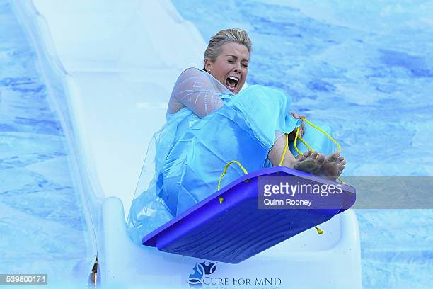 Samantha Armytage goes down the slide for Freeze MND during the round 12 AFL match between the Melbourne Demons and the Collingwood Magpies at...