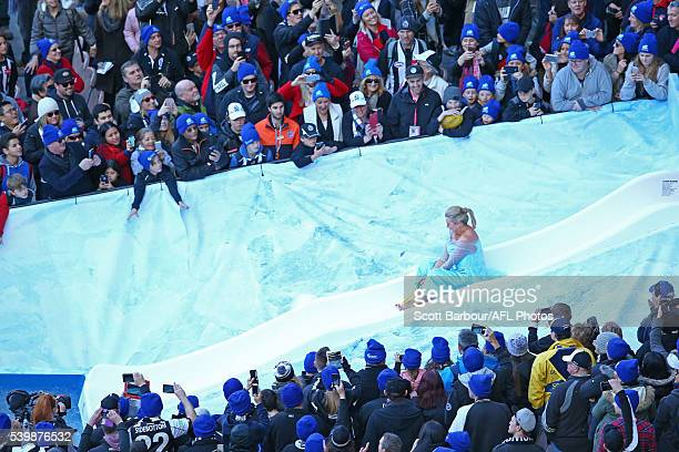 Samantha Armytage slides in the The Big Freeze 2 Celebrity Challenge during the The Big Freeze at the G during the round 12 AFL match between the...