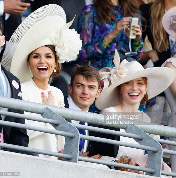 Samantha Barks Ben Atkinson and Eleanor Tomlinson watch the racing as they attend day 3 Ladies Day of Royal Ascot at Ascot Racecourse on June 18 2015...