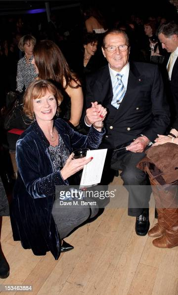 Samantha Bond and Sir Roger Moore attends '50 Years Of James Bond The Auction' celebrating the 50th anniversary of the film franchise and the first...