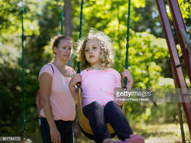 Samantha Brown pushes her daughter Kaylee on a swing at their South Berwick home on Thursday September 15 2016 Kaylee has a severe seizure disorder...