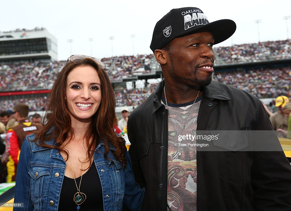 Samantha Busch, wife of driver Kyle Busch, meets with Curtis '50 Cent' Jackson before the start of the NASCAR Sprint Cup Series Daytona 500 at Daytona International Speedway on February 24, 2013 in Daytona Beach, Florida.