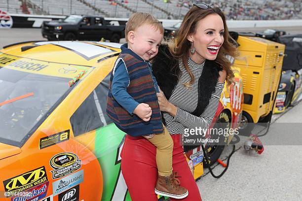Samantha Busch wife of Kyle Busch driver of the MM's Toyota stands on the grid with their son Brexton prior to the NASCAR Sprint Cup Series AAA Texas...