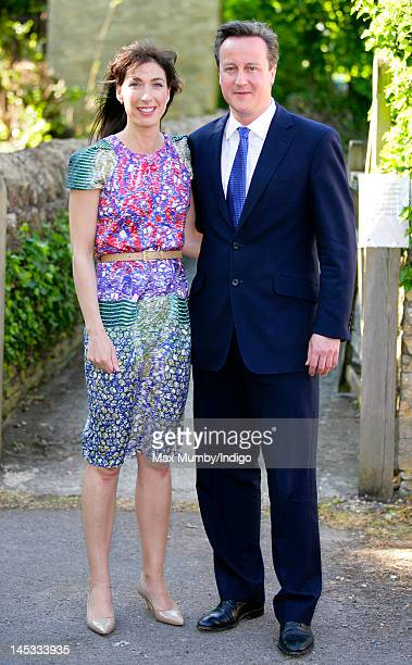 Samantha Cameron and Prime Minister David Cameron attend the wedding of Henry Allsopp and Naomi Gummer at The Church of St Nicholas Chadlington on...
