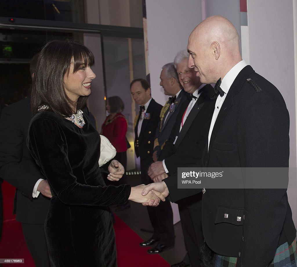<a gi-track='captionPersonalityLinkClicked' href=/galleries/search?phrase=Samantha+Cameron&family=editorial&specificpeople=624344 ng-click='$event.stopPropagation()'>Samantha Cameron</a> shakes hands with the editor of The Sun David Dinsmore during The Sun Military Awards at National Maritime Museum on December 11, 2013 in London, England.