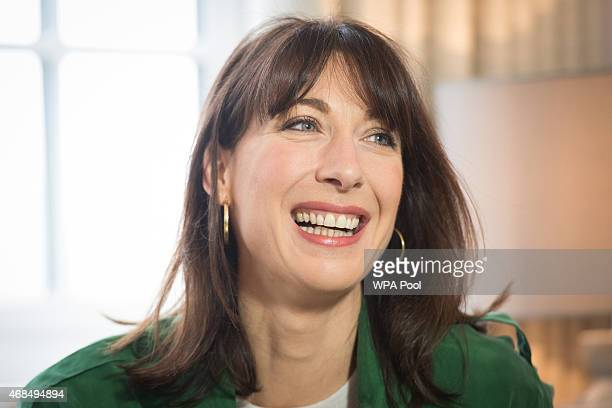 Samantha Cameron the wife of British Prime Minister and leader of the Conservative Party David Cameron reacts in a showhome during a general election...