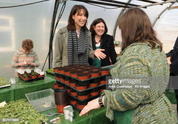 Samantha Cameron the wife of Conservative Party Leader David Cameron jokes with Sarah a beneficiary of the Caring For Life charity and Julia Mulligan...