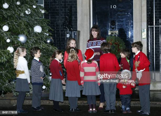 Samantha Cameron welcomes children from St Nicholas Preparatory School Kensington to number 10 Downing Street as she wears a Christmas Jumper as part...