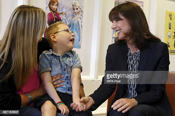 Samantha Cameron wife of Britain's Prime Minister David Cameron meets sixyearold William Moore and his mother Laura at the Hop Skip and Jump centre...