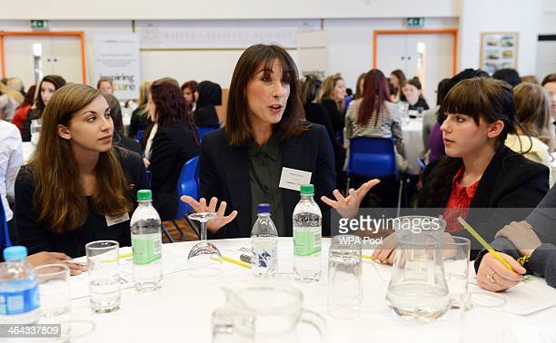 Samantha Cameron wife of British Prime Minister David Cameron talks to sixth formers Jodie Hooper and Martha Ryder at a Career Speed Networking and...