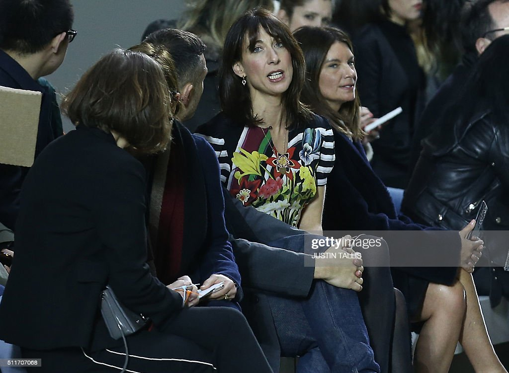 Samantha Cameron (C), wife of British Prime Minister David Cameron, waits in the audience for the start of the Christopher Kane catwalk show at the Autumn / Winter 2016 London Fashion Week in London on February 22, 2016. / AFP / JUSTIN