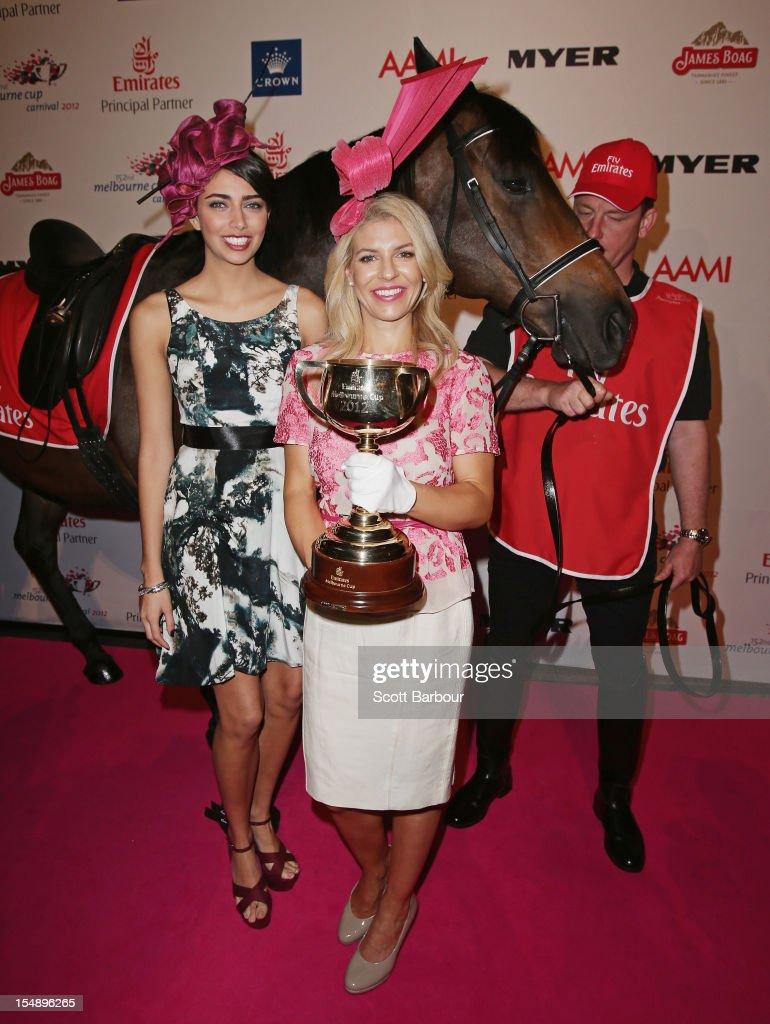 Samantha Downie, the Face of the Schweppes Flemington Fling and Alison Saville, the Myer Fashions on the Field Ambassador pose with the Melbourne Cup during the The 2012 Melbourne Cup Carnival Launch at Crown Palladium on October 29, 2012 in Melbourne, Australia.