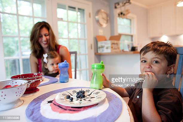 Samantha Dulles of Downers Grove Illinois spends time with her two children twoyearold Franny and fiveyearold Teddy while they eat peanut butter and...