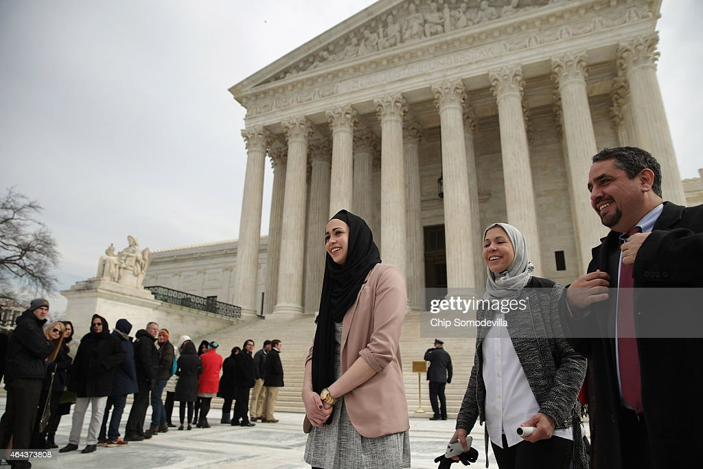 Samantha Elauf (C), her mother Majda Elauf (2nd R) of Tulsa, Oklahoma, and Equal Employment Opportunity Commission General Counsel David Lopez (R) leave the U.S. Supreme Court after the court heard oral arguments in EEOC v. Abercrombie & Fitch February 25, 2015 in Washington, DC. Elauf filed a charge of religious discrimination with the EEOC saying Abercrombie & Fitch violated discrimination laws in 2008 by declining to hire her because she wore a head scarf, a symbol of her Muslim faith.