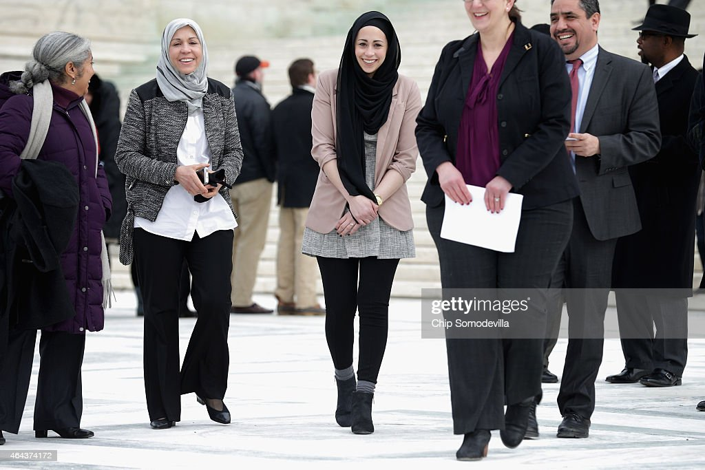 Samantha Elauf (C), her mother Majda Elauf (2nd L) of Tulsa, Oklahoma, and Equal Employment Opportunity Commission General Counsel David Lopes (2nd R) walk out of the U.S. Supreme Court after the court heard oral arguments in EEOC v. Abercrombie & Fitch February 25, 2015 in Washington, DC. Elauf filed a charge of religious discrimination with the EEOC saying Abercrombie & Fitch violated discrimination laws in 2008 by declining to hire her because she wore a head scarf, a symbol of her Muslim faith.
