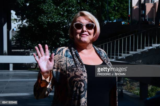 Samantha Geimer waves to the press before entering the courthouse in Los Angeles California on June 9 2017 Geimer is expected to ask the court to end...