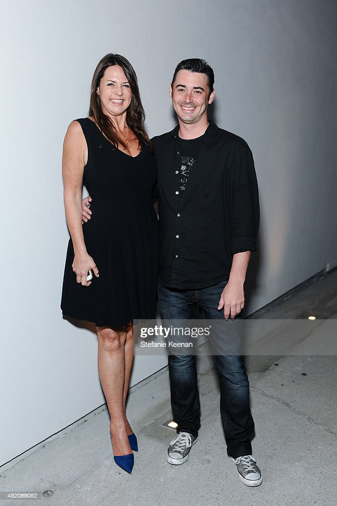 Samantha Glaser and William Weiss attend Joe Goode 'Flat Screen Nature' on July 12, 2014 in Los Angeles, California.