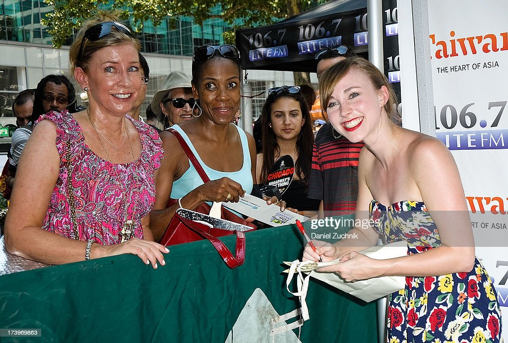 Samantha Hill(R) from 'Phantom of the Opera' signs autographs during 106.7 LITE FM's Broadway in Bryant Park 2013 at Bryant Park on July 18, 2013 in New York City.