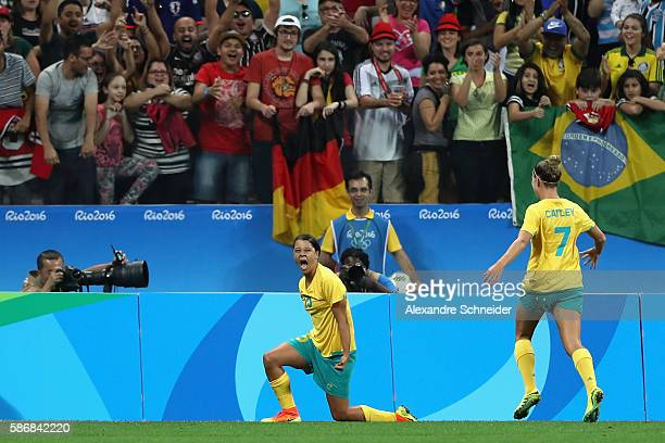 Samantha Kerr of Australia celebrates scoring a goal during the first half against Germany in the Women's First Round Group F match at Arena...