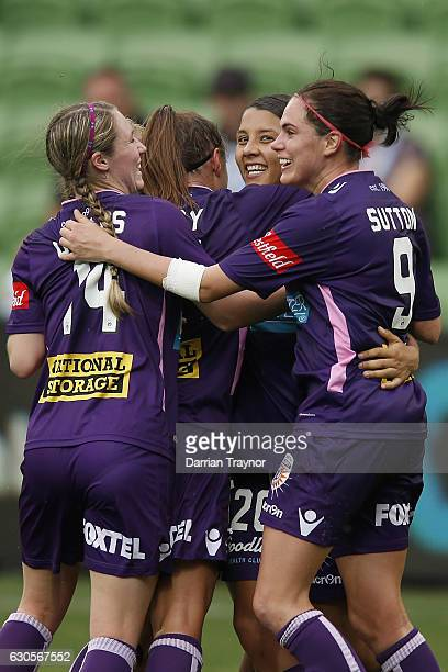 Samantha Kerr of Perth Glory celebrates a goal with team mates during the round eight WLeague match between Melbourne City and Perth at AAMI Park on...