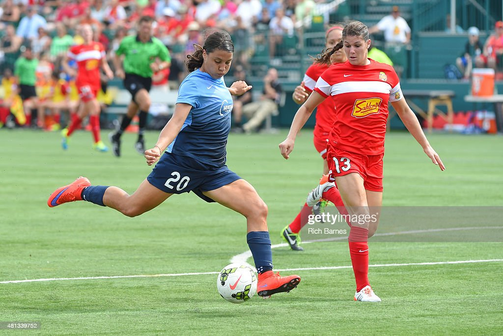 Samantha Kerr #20 of Sky Blue FC takes a shot around Brittany Taylor #13 of Western New York Flash during the first half at Sahlen's Stadium on July 19, 2015 in Rochester, New York.