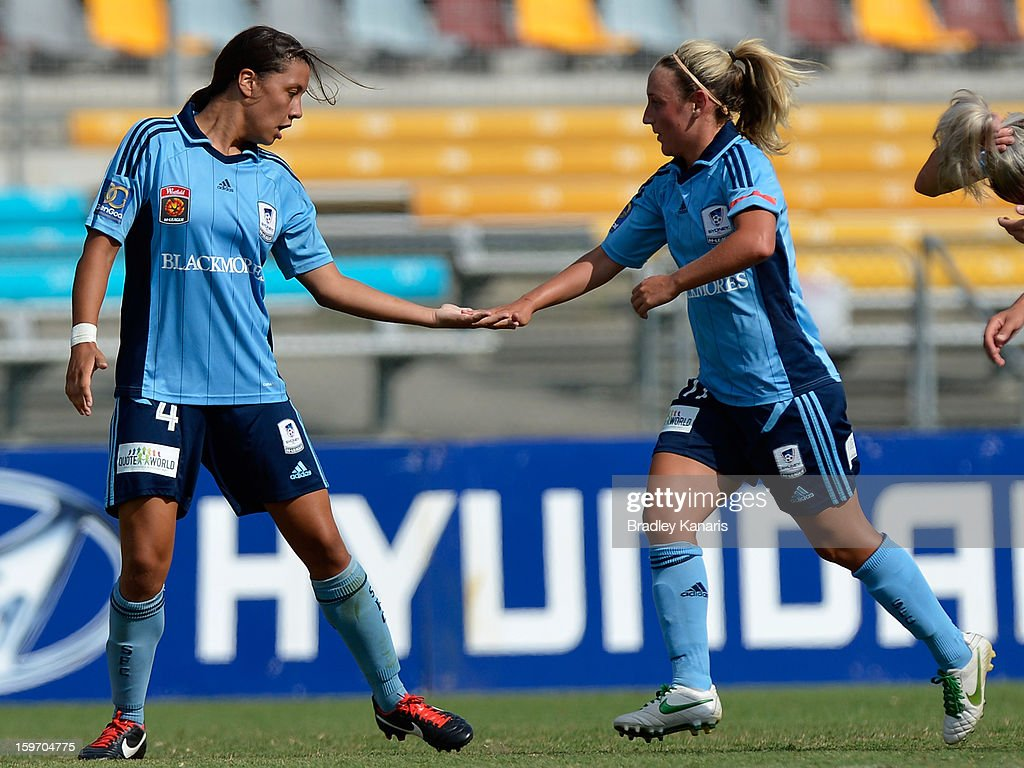 Samantha Kerr (L) of Sydney celebrates with team mate Annalie Longo after scoring a goal during the W-League Semi Final match between the Brisbane Roar and Sydney FC at Queensland Sport and Athletics Centre on January 19, 2013 in Brisbane, Australia.