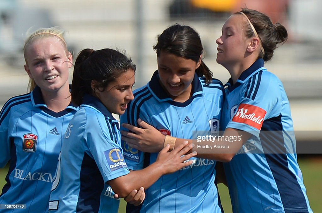<a gi-track='captionPersonalityLinkClicked' href=/galleries/search?phrase=Samantha+Kerr&family=editorial&specificpeople=4860468 ng-click='$event.stopPropagation()'>Samantha Kerr</a> (Centre) of Sydney celebrates with team mates during the W-League Semi Final match between the Brisbane Roar and Sydney FC at Queensland Sport and Athletics Centre on January 19, 2013 in Brisbane, Australia.