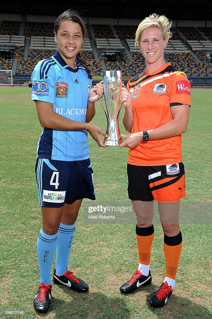 Samantha Kerr of Sydney FC and Elise Kellond-Knight of the Roar pose with the W-League trophy during the W-League FFA finals series launch at Queensland Sport and Athletics Centre on January 15, 2013 in Brisbane, Australia.
