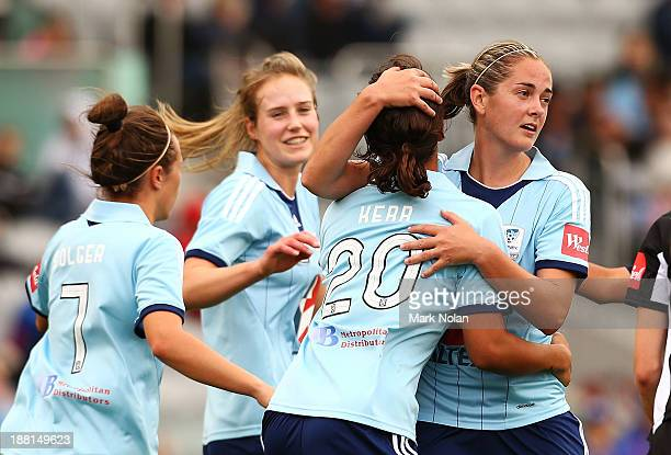 Samantha Kerr of Sydney is embraced by team mate Renee Rollason after scoring during the round two WLeague match between Sydney and Newcastle at WIN...