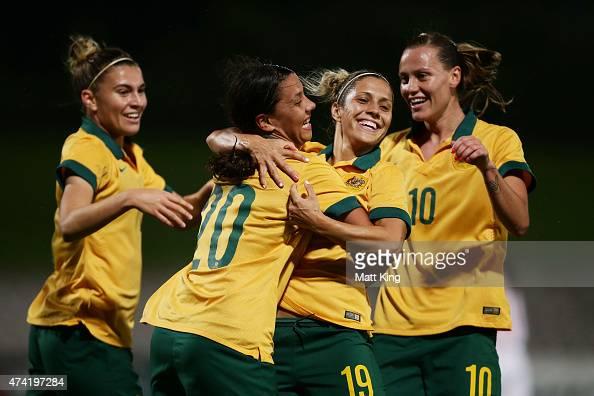 Samantha Kerr of the Matildas celebrates with team mates after scoring a goal during the international women's friendly match between the Australian...
