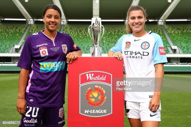 Samantha Kerr of the Perth Glory and Steph Catley of Melbourne City pose with the trophy during the WLeague Grand Final media opportunity at nib...