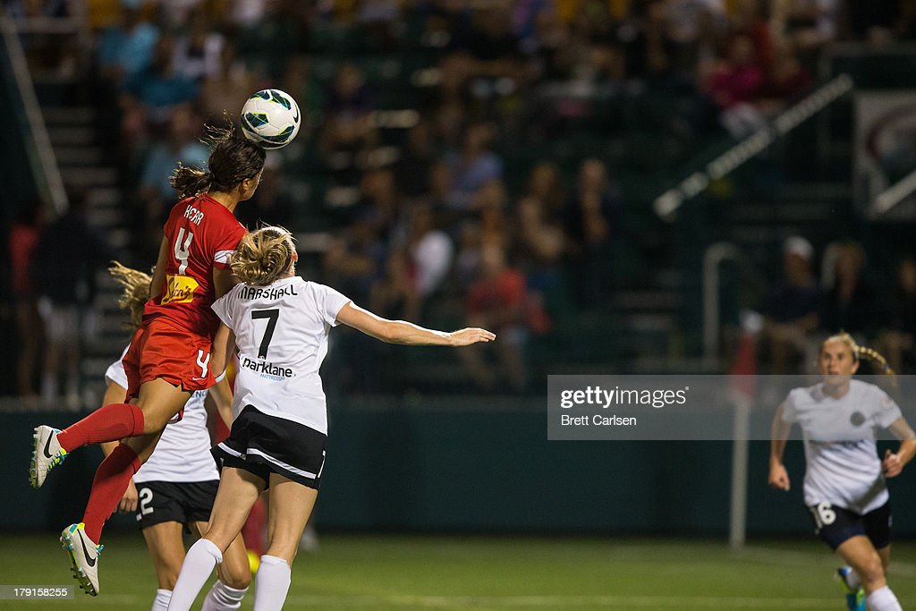Samantha Kerr #4 of Western New York Flash heads the ball over Portland Thorns FC's Nikki Marshall #7 and Christine Sinclair #12 in the National Women's Soccer League Championship at Sahlen's Stadium August 31, 2013 in Rochester, New York.