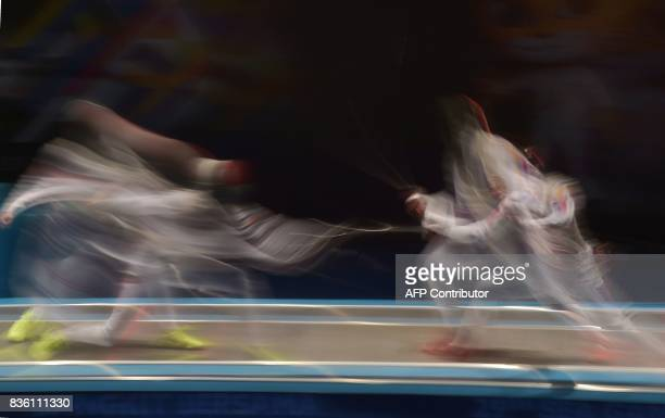 Samantha Kyle Catantan of the Philippines competes with Singapore's Amita Marie Nicolette Berthi during their women's foil individual fencing final...
