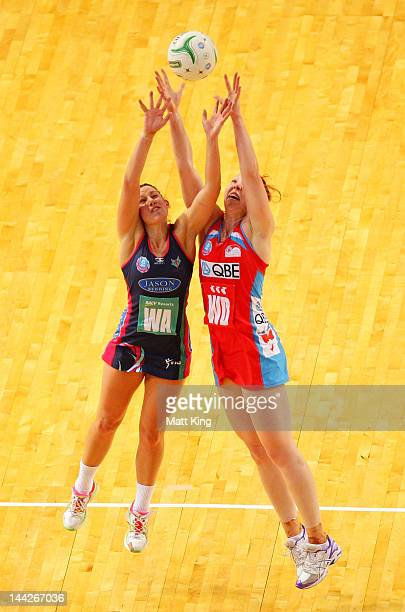 Samantha May of the Swifts and Madison Browne of the Vixens compete for the ball during the round seven ANZ Championship match between the Swifts and...